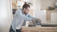 Male Carpenter In His Workshop
