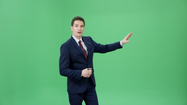 Male Caucasian weather presenter presenting the weather forecast