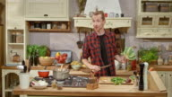 Male chef preparing a vegetable soup on a cooking show