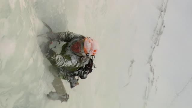 WS HA Male climber climbing ice, Hemsedal, Buskerud, Norway