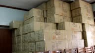 RAF6U308 male condoms boxes stacked to ceiling