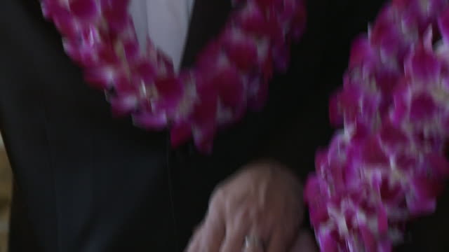 CU Male couple comparing wedding rings after their ceremony at San Francisco City Hall/ TU Men smiling/ TD Hands/ San Francisco California/ AUDIO