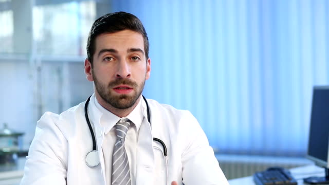 Male Doctor Talking At The Camera