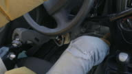 Male driver with prosthetic leg pushing car pedals