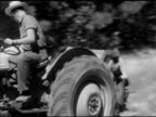 Male driving tractor Laneburg HS student riding behind planting seeds Sowing reforestation reforesting Nevada County Arkansas AR