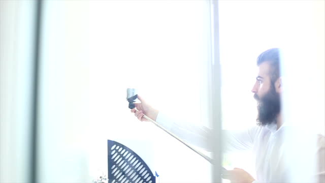 Male employee making selfie at workplace in office