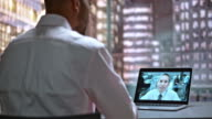DS Male employee on a video call with his colleague