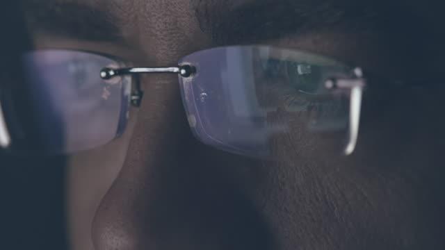 Male eyes looking at computer monitor