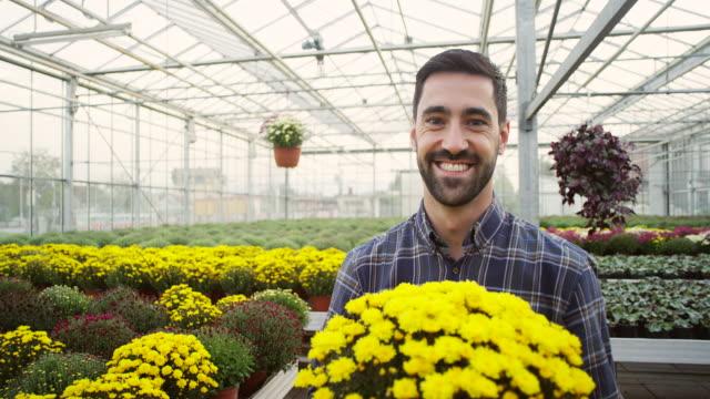 Male florist at garden center