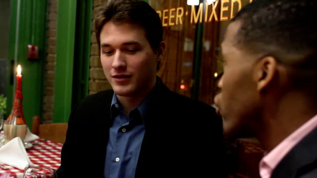 Male Friends Talk in Restaurant