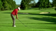 SLO MO WS Male Golfer Teeing Off