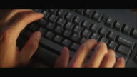 CU HA Male hands typing on computer keyboard