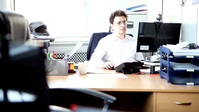 Male lawyer sitting in office