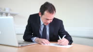 Male lawyer writing report