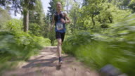 TS Male marathon runner running on a forest path