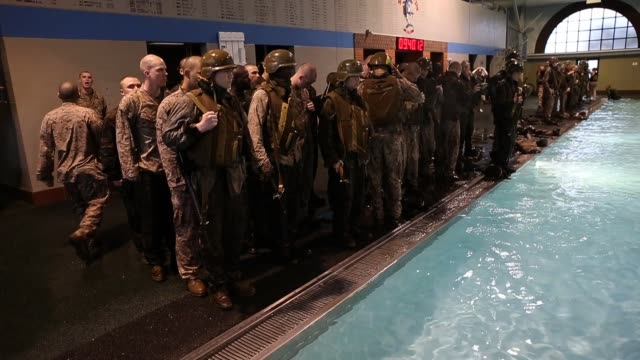 Male Marine recruits learn to remove body armor while under water during boot camp February 25 2013 at MCRD Parris Island South Carolina Women Attend...