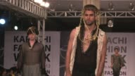 Male models take the runway at Karachi Fashion Weeks first ever two day mens show CLEAN First ever mens fashion show at Karachi on May 27 2013 in...