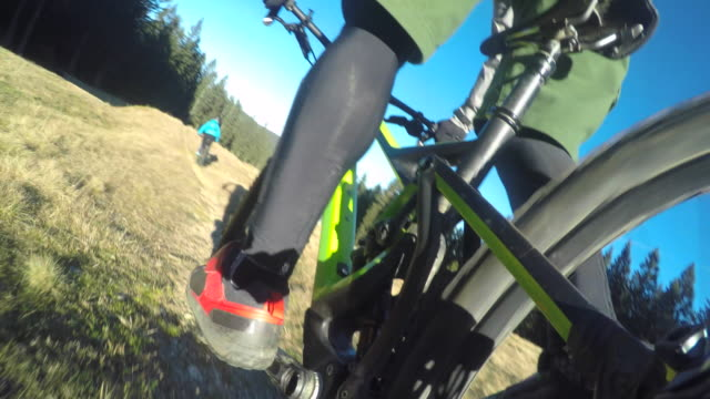 POV Male mountain biker riding down the trail