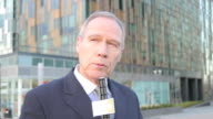Male news reporter on location