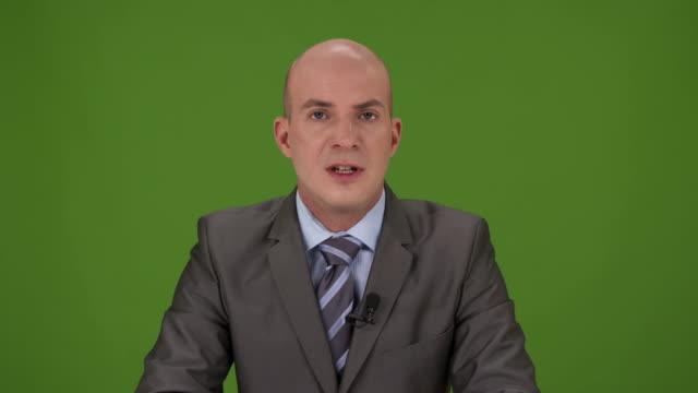 HD: Male Newscaster Reading A News Bulletin