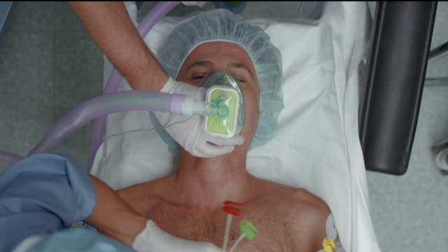 Male patient inhaling anesthetic before operation
