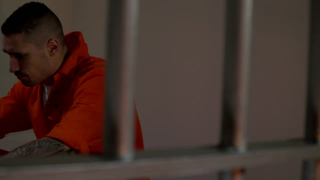 4K Male Prisoner in Jail Cell - Behind bars