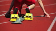 Male Runner Sprinting Off Starting Block Close-up