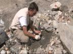 Male scientist taking glacier samples, Himalayas