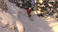 Male skier drops into steep back-country terrain / Blaine County, Idaho, United States