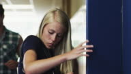 MS TU Male student approaching female friend (16-17) in school corridor / Spanish Fork City, Utah, USA