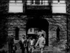 Male students walking through building archway WS Men walking sidewalk by Ivy covered building HA WS People walking sidewalks in Harvard Yard men...