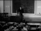 Male students walking up steps into building DRAMATIZATION MS 'Ray' sitting in seat at lecture LECTURE CLASS HA WS Unidentified professor standing...