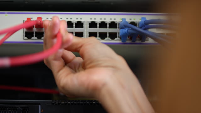 Male technician working on a computer in the server room