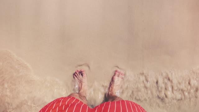 Male Tourist Standing on a Beach
