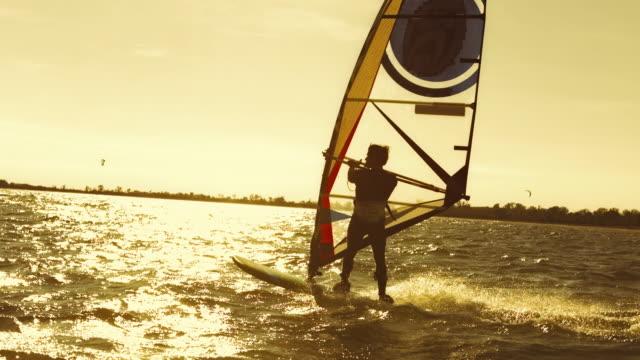 Male windsurfer windsurfing