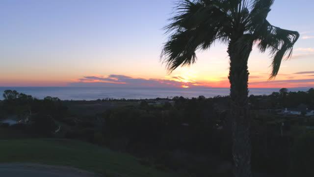 Malibu sunset over ocean in slow motion
