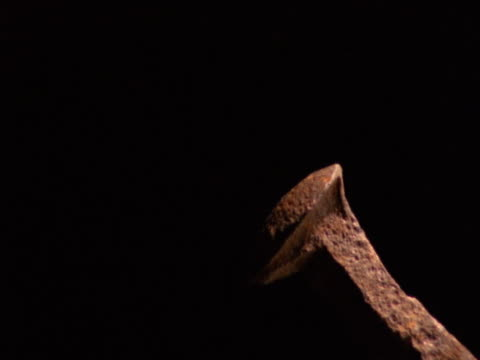 Mallet hammering metal stake