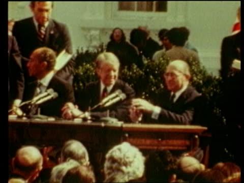 Malta hijack RR 8304A UPITN Jimmy Carter seated at PKF after Camp David accords signing PULL OUT to Menachem Begin and Anwar Sadat LTS Crowds of...