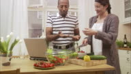 A man and a woman preparing a salad together Sweden.