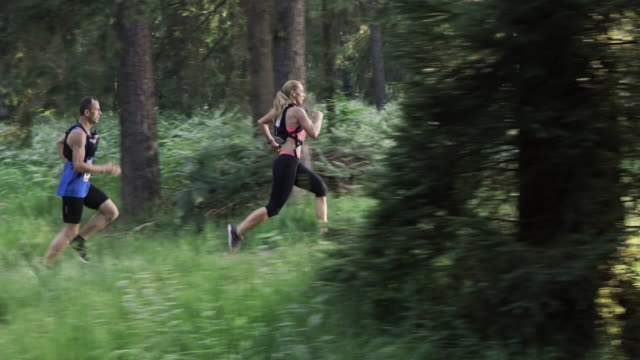 SLO MO DS Man and a woman running a trail marathon