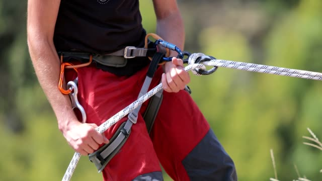 Man and climbing equipment