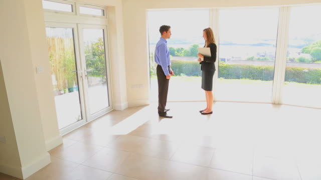 Man and estate agent shaking hands