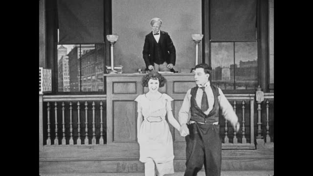 Buster Keaton and fiancŽ announce marriage to upset family members in courtroom
