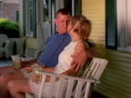 Man and wife on porch swing