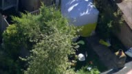 Man and woman charged with murder after badly burned body found in garden of house in Southfields ENGLAND London Southfields Forensic tent in garden...
