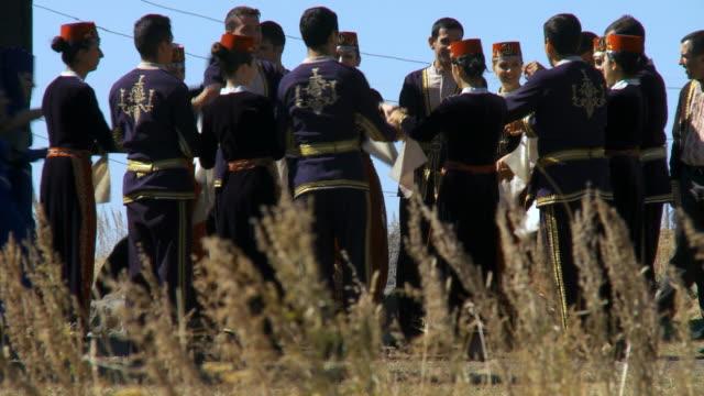 MS Man and woman dancing armenian folk dance  / Armenia