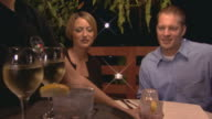 man and woman having a quite dinner at restaurant