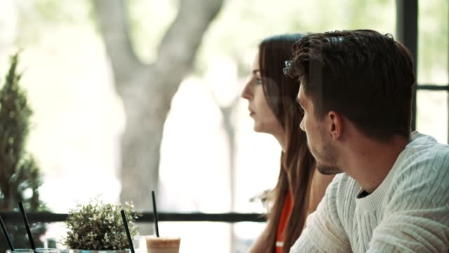 Man and woman in cafe