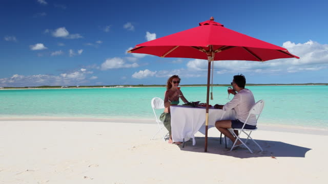 Man and Woman Lunching in front of a lagoon