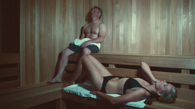 WS Man and woman relaxing in sauna / Bellevue, Washington, USA